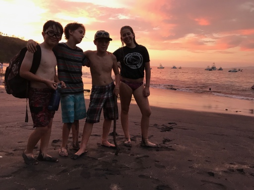 this is my friends and i at the beach after sunset