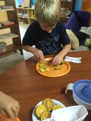 Preparing snack for the class, the Starfruit grows at school